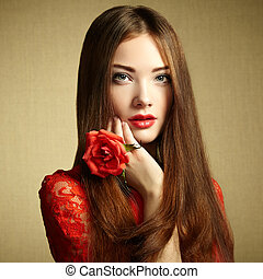 Portrait of beautiful dark-haired woman with flowers....