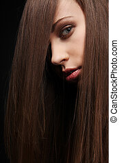 Dark hair. - Beautiful young woman with long healthy dark...