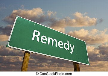 Remedy Green Road Sign with dramatic clouds and sky