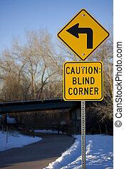 Blind corner turning warning sign on biking trail - Yellow...