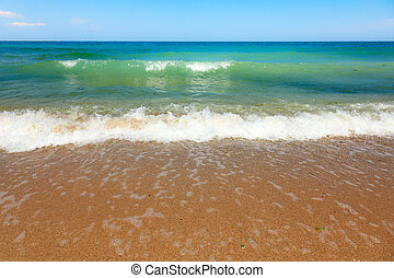 Sea waves at he beach - Calm sea waves and clear sky at the...