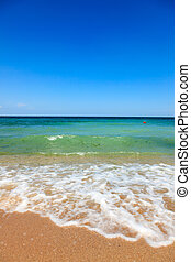 Sea waves at the beach - Calm sea waves and clear sky at the...