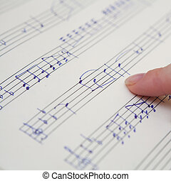Music book with handwritten notes - Finger pointing to Music...