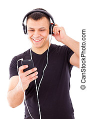 sexy man listening mp3 player with headphones - sexy man...