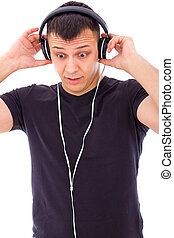 man surprised by something unexpected on headphones - man...