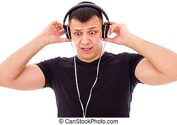 man shocked by what he hears on headphones - man shocked by...