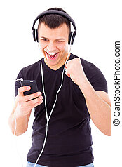 man listening playlist on mobile phone wearing headphones -...