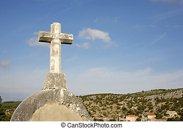 cross on blue sky - white stone cross on blue sky and cloudy...