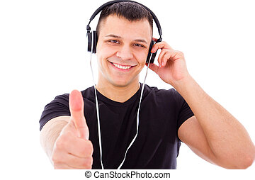 smiling dj with headphones showing thumbs up - smiling young...