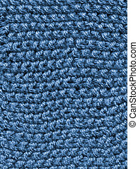 Blue knitted wool close up abstract texture background.