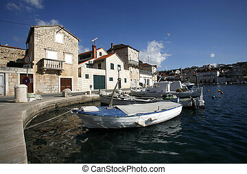 fishing village - Small fishing boat in harbour of Milna on...