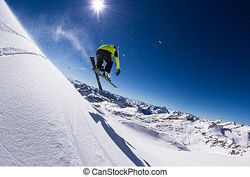 Alpine skier on piste, skiing downhill - Alpine skier in...