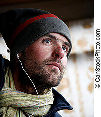 man - Young male listening to music with earphones