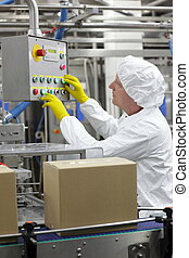 Controlling production - Caucasian man worker in white...