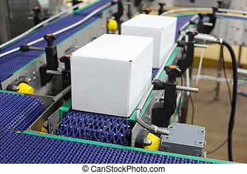 Automation - conveyor belt - Cardboard boxes on conveyor...