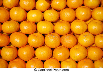mandarines - Colourful display of mandarines on traditional...