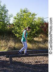 Balance beam - Young girl on balance beam