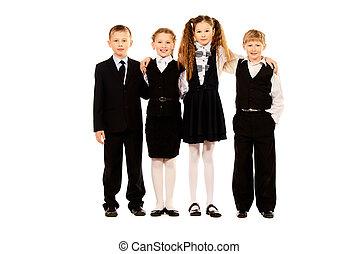 school uniform - Group of cheerful schoolchildren standing...