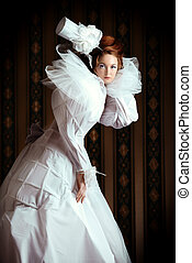 old fashion - Beautiful fashion model in the refined white...