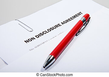 Non disclosure agreement showing out of white envelope with...