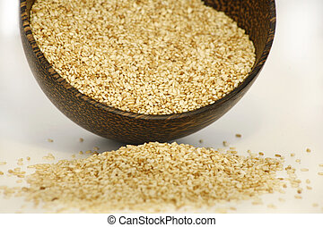 linen - Sesame seeds in coconut bowl isolated on white...