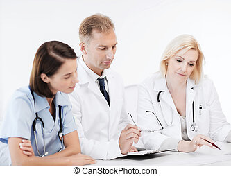 team or group of doctors on meeting - healthcare and medical...
