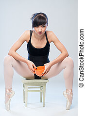aggressive gymnast sitting on a chair with cup - aggressive...