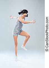 Funny girl in pajamas walks forward and sings