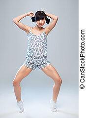charismatic girl in pajamas dancing