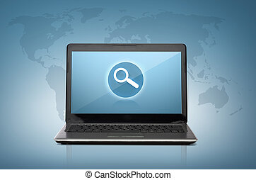 laptop computer with magnifying glass on screen - technology...
