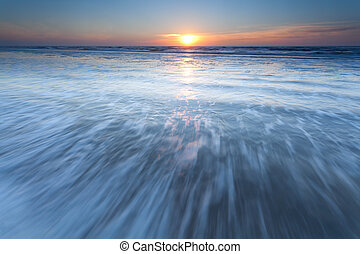 North sea waves at sunset