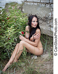 nude woman against nature background - Beautiful young nude...