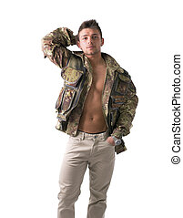 Muscular young man with military jacket on naked torso