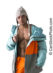 Attractive young male skier or snowboarder with open coat