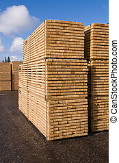Lumber and timber - Piles of pine planks stacked for drying