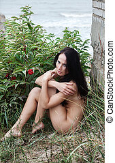 nude woman against old wall and sea background - Beautiful...
