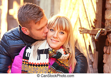 Love story couple - Young couple kissing on the street of...