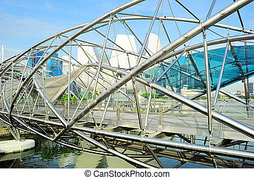 Helix Bridge and downtown of Singapore - The Helix Bridge in...