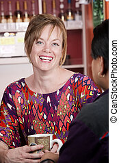 Woman in coffee house with male friend