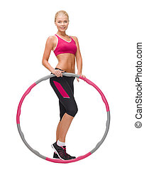 young sporty woman with hula hoop - fitness, sport and...