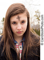 Ash Wednesday - Cute teenage girl with cross for Ash...