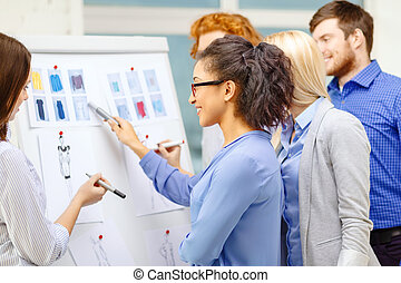 designers choosing clothes designes at office - fashion,...