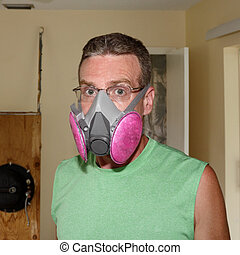 Wearing a Mold Mask - Caucasian man wearing a pink and gray...