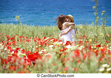 Happy young couple on a meadow - Happy young couple kissing...