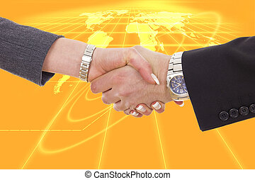 business shaking hands in front of earth map