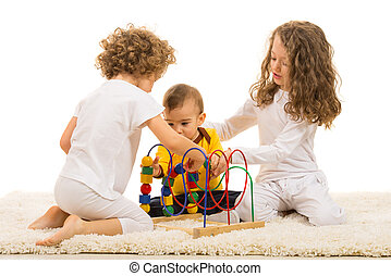 Children playing with wooden toy home and sitting together...