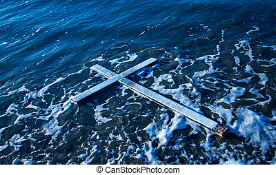 Floating Cross - White cross floating on water with some...