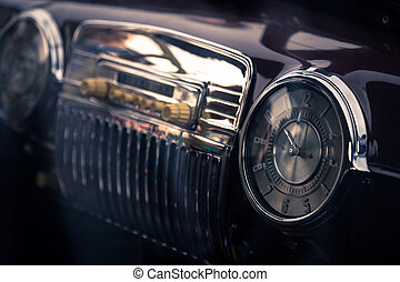 Retro interior of vintage car - Clock in retro interior of...