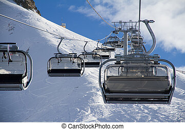 Chairlift in ski resort Krasnaya Polyana, Russia - Chairlift...
