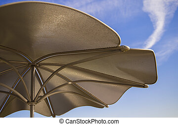Metal Umbrella against Blue Sky - Metal Umbrella against...